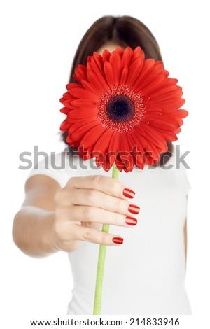 Beautiful woman with flower gerbera in her hands against white b Stock photo © rozbyshaka