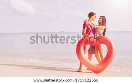 Couple stood at the beach Stock photo © photography33