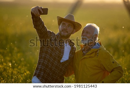 Farmer Taking Photo of Young Wheat Cultivation Field Stock photo © stevanovicigor
