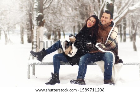 Couple walking in winter snow, showing love and romantic concept stock photo © jaffarali