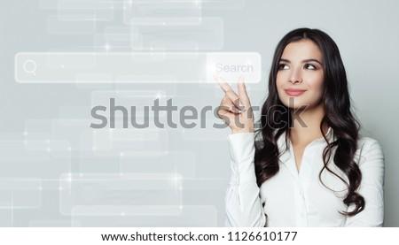 Młodych kobieta interesu dotknąć internetowych przeglądarka adres Zdjęcia stock © ra2studio