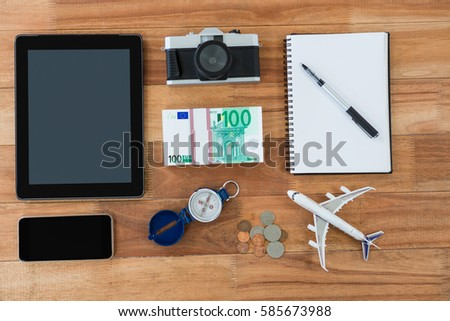Digital camera, dairy, pen, map, compass and airplane model on table Stock photo © wavebreak_media