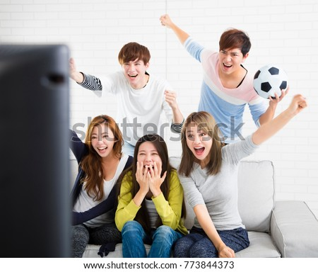 Asian football supporters group of friend watching soccer sport  Stock photo © snowing