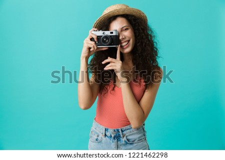 Portrait of cute woman 20s wearing straw hat photographing on re Stock photo © deandrobot
