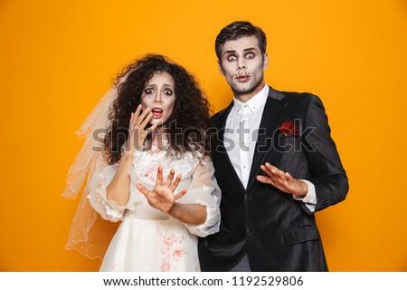 Photo of spooky zombie woman on halloween wearing wedding dress  Stock photo © deandrobot