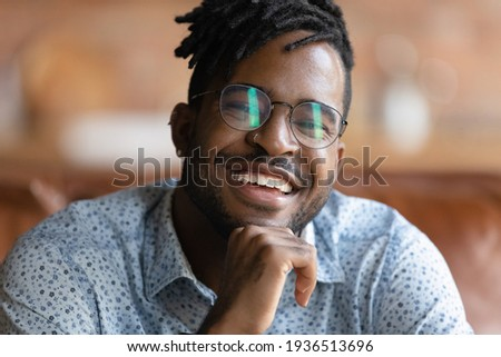 portrait of happy african man having stylish afro hairdo showing stock photo © deandrobot