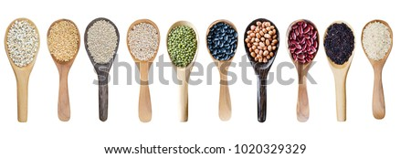 Wooden spoon of raw organic red rice on white background. Healthy food.  stock photo © DenisMArt