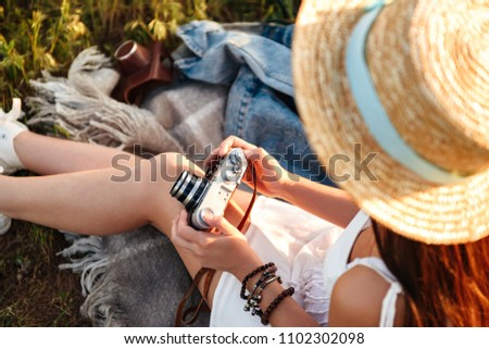 Cropped image of european woman wearing straw hat holding retro  Stock photo © deandrobot
