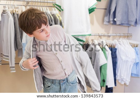 The boy tries on clothes in the childrens clothing store BANNER, long format Stock photo © galitskaya