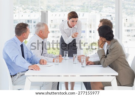 Businessman Getting Irritated With Colleague Talking On Phone Stock photo © AndreyPopov