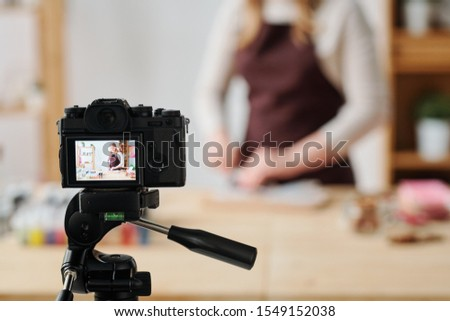 Creative woman in home camera recording soap making master class for subscribers Stock photo © pressmaster