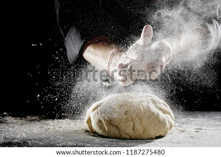The chef cooks the dough sprinkled with flour freezing in motion Stock photo © Illia