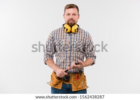 Boldog fiatal szakállas szerelő fülhallgató kalapács Stock fotó © pressmaster