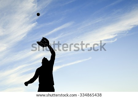 man silhouetted by the sunset is just beginning catch ball with glove Stock photo © Lopolo