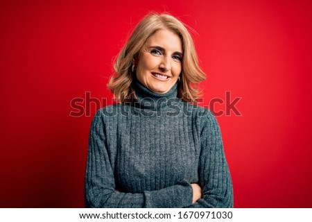 A Beautiful blonde woman posing standing facing the camera. Stock photo © Lopolo