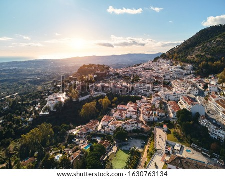 Aerial photo distant view charming Mijas pueblo, typical Andalus Stock photo © amok
