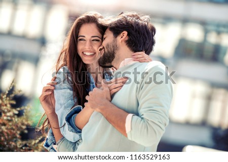Young loving couple kissing and enjoying the company of each other outdoors Stock photo © GVS