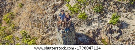 BANNER, LONG FORMAT Young tourist man and woman sit at the edge of the crater of the Ijen volcano or Stock photo © galitskaya