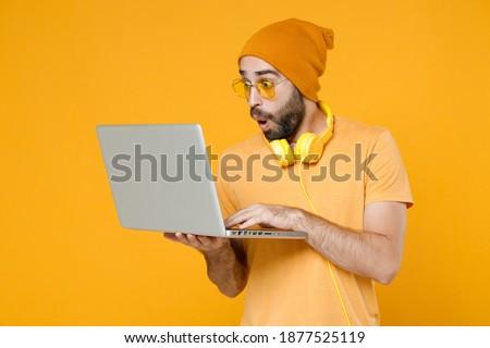 Image of young bearded man wearing basic white t-shirt running Stock photo © deandrobot