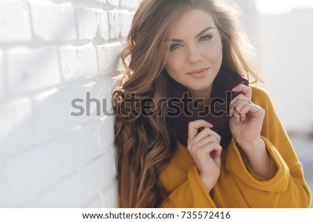 Photo of pretty happy woman in knit hat posing and smiling at camera Stock photo © deandrobot