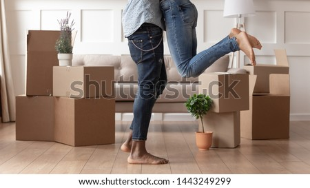 happy woman with stuff moving to new home Stock photo © dolgachov