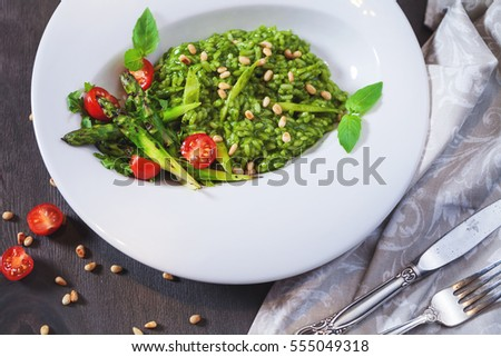 Black food background with asparagus, cherry tomatoes and rosemary on black background with black pe Stock photo © DenisMArt
