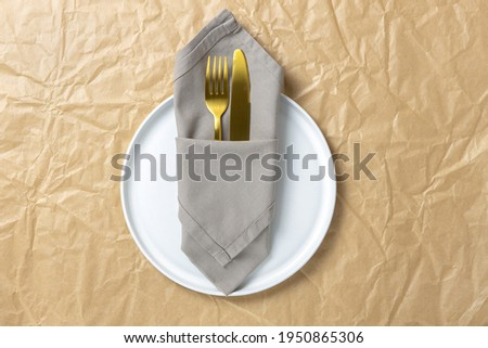 Served kitchen table with cookware and textile napkin in black colors. Stock photo © artjazz