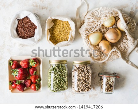 Fresh strawberries in eco-friendly package on white wooden background. Vegetarian organic meal Stock photo © dash