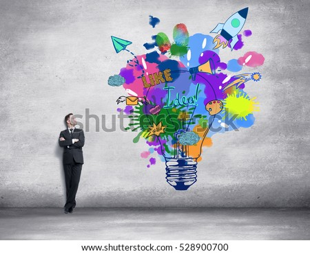 man drawing colorful light bulb Stock photo © ra2studio