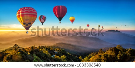Colorful hot air balloons flying over mountain. Traveling, planning summer vacation Stock photo © robuart