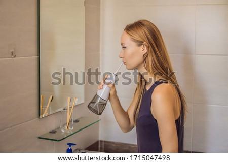 Vrouw oraal badkamer water gelukkig medische Stockfoto © galitskaya