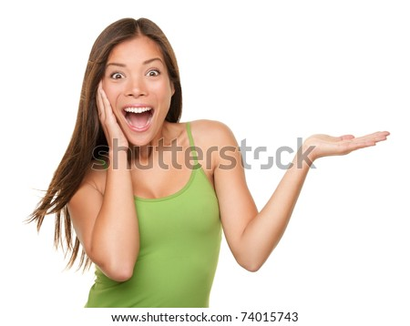 Image of excited woman expressing surprise and pointing finger upward Stock photo © deandrobot