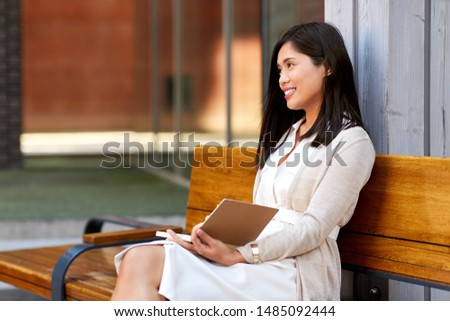 asian woman with notebook or sketchbook on bench Stock photo © dolgachov