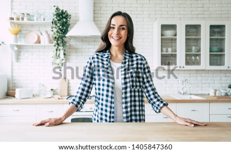 Pretty woman  at the kitchen Stock photo © Nobilior