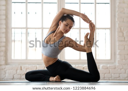Portrait of healthy young lady practicing yoga exercise - Spine  Stock photo © HASLOO