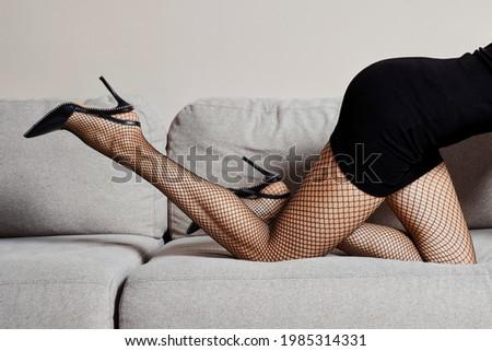 Mulher em fishnet meia-calça calcanhares Foto stock © pxhidalgo
