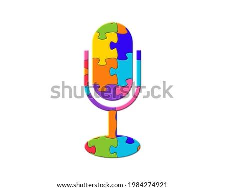 Microphone Icon on Multicolor Puzzle. Stock photo © tashatuvango