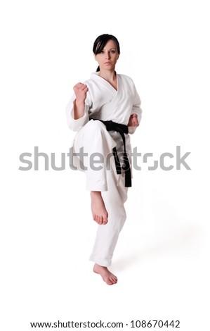 Gyönyörű kaukázusi fiatal nő karate kimonó fehér Stock fotó © lightpoet