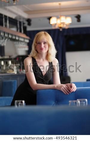 beautiful blond woman in evening dress standing near bar counter stock photo © nejron
