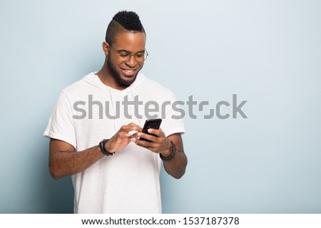 Young african-american man in casual cloths isolated on white background Stock photo © deandrobot