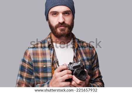 Handsome young bearded hipster relaxing with old-fashioned camer Stock photo © DisobeyArt