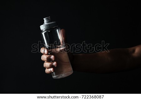 Cropped photo of afro american males hand holding bottle with wa Stock photo © deandrobot