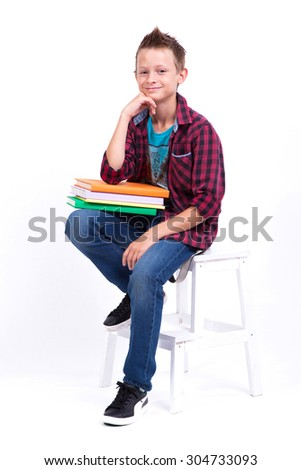 tired schoolboy European appearance in shirt and jeans sitting o Stock photo © Traimak