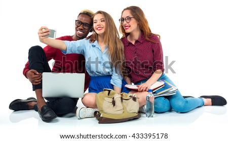 happy students with books laptop bags and makes selfie on whi stock photo © vlad_star