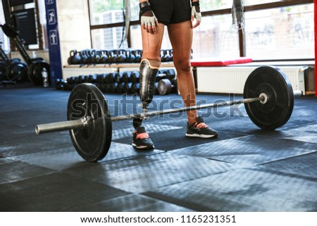 Cropped image of athletic caucasian disabled woman wearing prost Stock photo © deandrobot