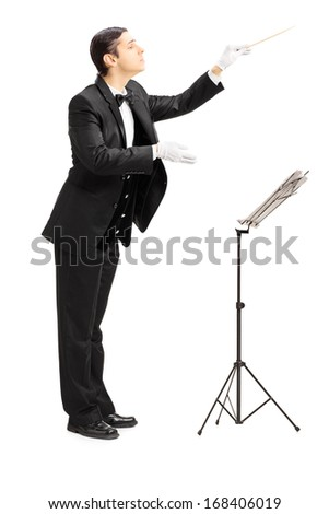 portrait of young orchestra conductor performing with a baton Stock photo © feedough