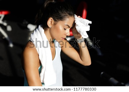 Tired sports woman using towel with closed eyes after training Stock photo © deandrobot