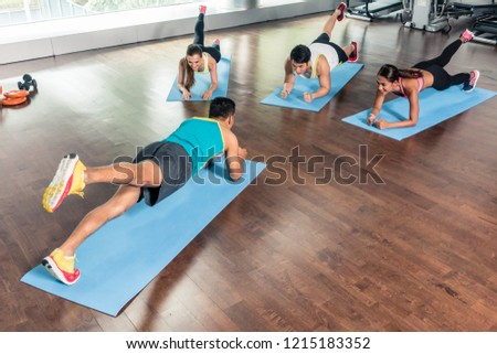 High-angle view of a fitness instructor during group calisthenics Stock photo © Kzenon