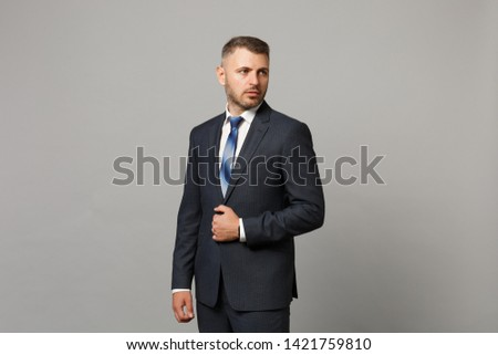 image of handsome man 30s in formal suit posing on camera while stock photo © deandrobot