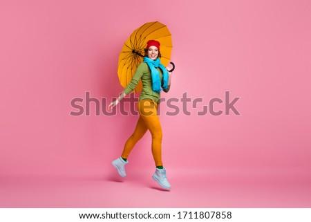 Cute donna indossare sciarpa ombrello Foto d'archivio © deandrobot